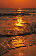 like a river of gold .... (Leone Fabre) Tags: sunset sea bali colour beach water true indonesia batubelig balisunset riverofgold croppingonly sunsetbythebeach abcopen:project=reflections