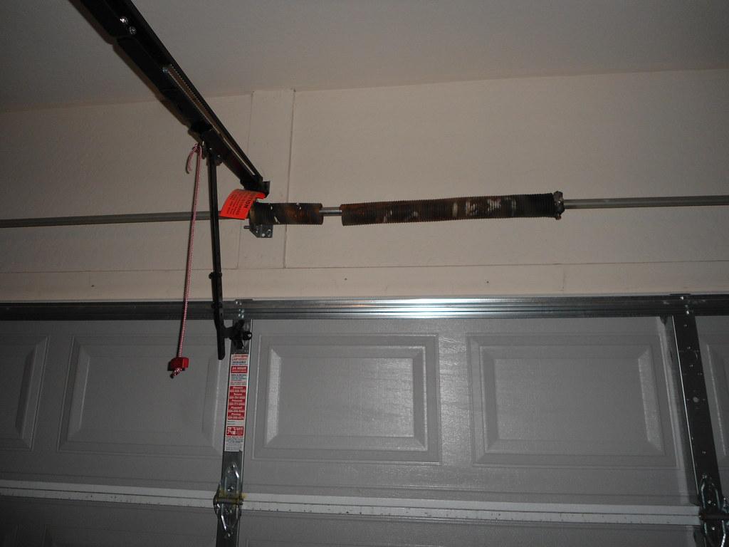 Repairing garage door panels repairing garage boiler for Garage door repair chandler