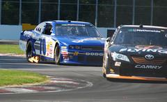 Blake Koch - flames, NASCAR Nationwide Napa 200, Montreal (PJMixer) Tags: nikon quebec montreal wip nascar racecars infocus highquality