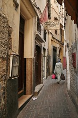 Tangiers alleyway (sonofwalrus) Tags: africa woman slr canon alley morocco tangiers  eos400d