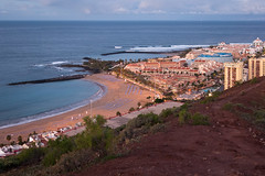 Toffee Apple (Jussi V) Tags: ocean morning travel blue winter red sea sky espaa cloud brown building green beach nature water landscape hotel coast spain bush europe cityscape horizon tenerife vegetation february canaryislands islascanarias adeje playadelasamricas montaachayofita