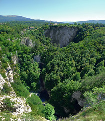 kocjan village on top of it's sinkhole (Bn) Tags: world park bridge heritage archaeology nature river giant geotagged hall waterfall topf50 rocks crossing treasure hole sink natural blind earth great rocky reserve biosphere center canyon unesco drain caves slovenia journey valley chamber mysterious limestone gorge cave jules walls slovenija swallow stalagmite explorat
