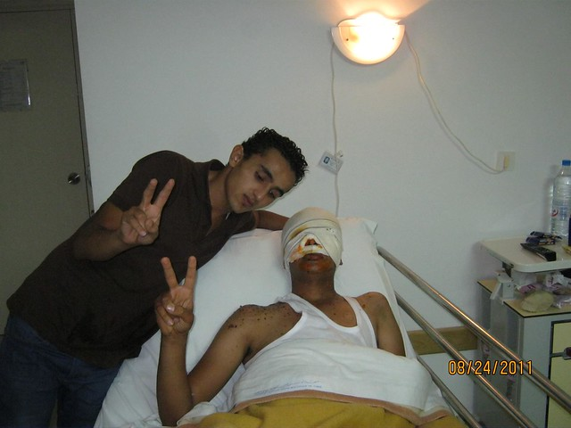 Omar with Adbu after he got out of surgery