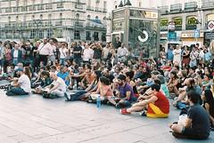 Indignados at Puerta del Sol (Miguel Pires da Rosa) Tags: madrid espaa film analog 50mm iso100 spain espanha sitting fuji protest olympus expired olympusom2 zuiko om2 reala manif puertadelsol om2sp mpires indignados piresdarosa miguelpiresdarosa