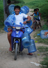 the age of aquarius (ubo_pakes) Tags: life street blue portrait man water work bottle nikon asia niceshot philippines transport environmental container motorbike cebu delivery cooler cebucity visayas loaded d60 ubo pakes inayawan mygearandme