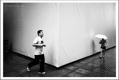 Optical illusion (tany_kely) Tags: china street leica urban blackandwhite bw woman white man black wall umbrella giant big noir shanghai angle noiretblanc femme small optical grand running run nb illusion jogging rue mur gant blanc optique jogger chine homme petit parapluie urbain m9 naine coureur