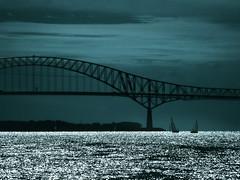 Deux rives, deux voiliers.. (Amiela40) Tags: bridge sailboat river structure shore pont fleuve stlawrenceriver rive voiliers fleuvestlaurent laviolette photoquebec crazygeniuses whaticallart