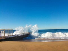 A Huge Blue Tropical Wave (Ewan McIntosh Photography) Tags: blue white green beach wet water sign concrete photo sand no jetty wave foam tropical huge entry