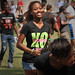 Student runs to catch up with her friends at the UAB Black Students Board Back to School Jam on Harris Field.
