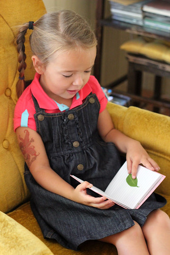 studying her leaf book