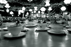Tea Cups. (lizzy.stardust) Tags: people black speed fun exposure slow alice disneyland disney shutter teacups wonderland whote latterns