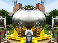 Woof. (joefutrelle) Tags: ocean sea reflection face metal ball mirror woods shiny hole steel weld deep surreal vessel science symmetry submarine research sphere porthole reflective symmetric effect alvin institution personnel oceanography submersible whoi oceanographic submergence