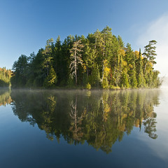 Good Morning and Hello Autumn! (Canadapt) Tags: trees mist lake reflection fog sunrise island keefer colorphotoaward sonyamount canadapt bestcapturesaoi dt1680mmf3545za zeisscontest2011 jmpick