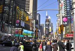 The hustle and bustle of Times Sq NYC (Belhaven2011) Tags: pictures street nyc people newyork trafficlights streets cars yellow advertising photo nikon traffic theatre photos cab crowd broadway picture police taxis midtown busy timessquare 1855mm 1855 lionking crowded 42ndstreet theatreland theatredistrict hustleandbustle minskoff d5000 belhaven2011