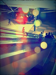 Descent (Irene2005) Tags: light airport bokeh escalator fake crossprocessing descend sliding rdu goingdown iphone airportboredom hss iphonecamera iphoneapp iphoneography sliderssunday takenandeditedwithiphone4