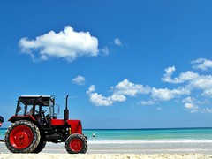 09-05-11 Labor Day Beach Party 15 (derek.kolb) Tags: ocean red tractor beach water clouds sand havana cuba favorites tire lahabana playasdeleste playamicayito
