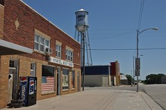 Small Town Kansas (ricko) Tags: mainstreet watertower americanflag storefront kansas pepsimachine cawkercity winkelbodyshop