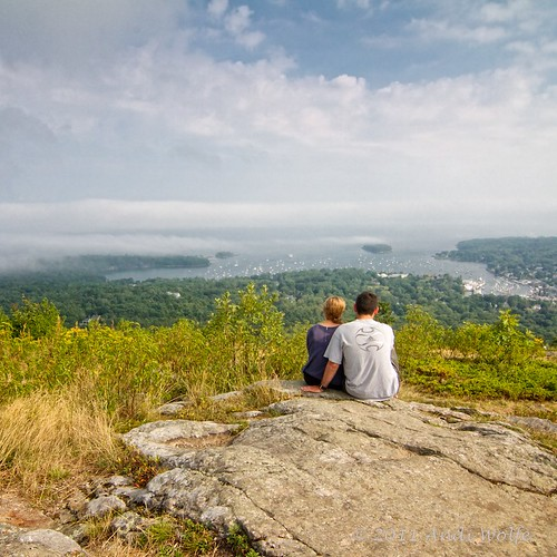 Young couple enjoying the view of Camden Harbor from Mount Battie by andiwolfe