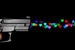 Killing Me Softly (Franois Doroth) Tags: light blur color colour colors hearts lights gun colours heart bokeh couleurs coeur weapon pistol couleur flou pistolet coeurs sigsauer sp2022