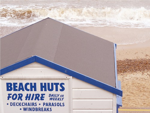 Beach huts for hire by PhotoPuddle