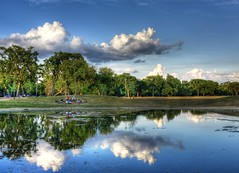 Reflections of Youth (Ken Yuel Photography) Tags: canada winnipeg manitoba assiniboinepark reflectionsofclouds digitalagent kenyuel teenagershangingout assiniboineparkduckpondwinnipeg kidsonthebank manitobaevening x100camera ridemybicycle