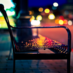 Bench (Standard Deluxe) Tags: city light canada wet rain night bench 50mm downtown bc bokeh britishcolumbia victoria vancouverisland 50l canonef50mmf12lusm featuredonadidapcom