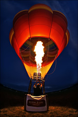 hot air balloon - children's miracle network (Dan Anderson.) Tags: festival wisconsin night fire evening flying airport glow fiesta basket hotair rally balloon floating flame hotairballoon bluehour burner wi ballooning nightglow cmn wisconsinrapids childrensmiraclenetwork alexanderfield rainbowsedge peteasp
