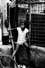 Alone ... (prasmohanty) Tags: poverty bw india childhood children blackwhite child innocence kolkata calcutta