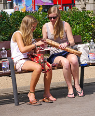 Bread for lunch (chrisk8800) Tags: barcelona street city travel girls friends vacation people urban woman holiday girl bench square bread lunch women legs candid streetphotography tourist blonde attractive shorts visitor appealing