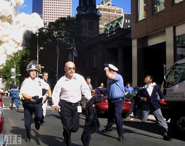 men running from 9/11
