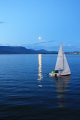 Moon and boat at sunset in Reykjavik (Albert Freeman) Tags: sea moon water night boat dusk reykjavik sailingboat
