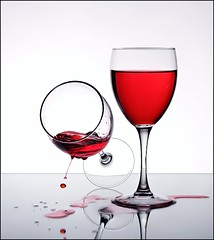Tipsy (Karen_Chappell) Tags: red two stilllife white fall glass glasses wine drop falling gravity tip alcohol spill liquid
