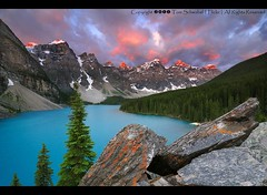 Canada's Most Famous View (pdxsafariguy) Tags: blue trees lake snow canada mountains clouds sunrise nationalpark rocks alberta banff lichen lakelouise glacial morainelake tomschwabel stunningskies