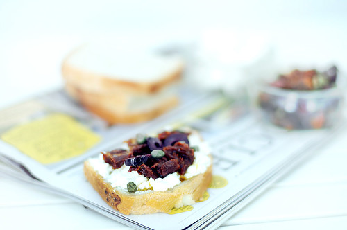 Tomato, olive and goat cheese sandwich