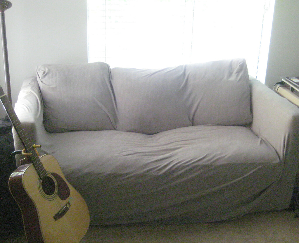 Pull-out-Bed Sofa / Wide Loveseat (Folds out into Bed) - Shown with Green Slip cover /White cloth cushion covers underneath -  Photo 1