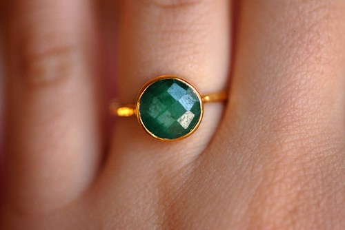 model wearing 18k hand hammered gold & emerald ring