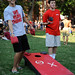 Students play a game of corn hole on Tucker/Owen beach.