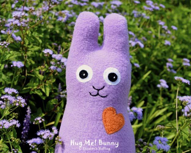 Lavender fleece Hug Me Bunny Rabbit by Elizabeth Ruffing, with lavender ageratum