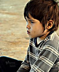 [ Street Portrait 2 ] (Marwa Alismail) Tags: street boy 2 portrait sad تصوير شارع حزن طفل بريئه بورتريه نظره تأمل