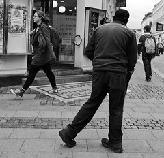 Going where? (ockie50) Tags: street leica bw lund walking candid streetphotography summicron frombehind m9 iso2000 summicron352asph leicam9