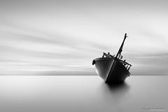 Sleepy boat (Mustafa Al Shakhori) Tags: ocean old longexposure sea sky bw cloud seascape motion nature clouds landscape boat ship naturallight nd leefilter3stop mustafaalshakhori