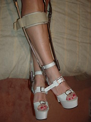 Model Shows Her Braced Crossed Legs and Sexy Sandals (KAFOmaker) Tags: sexy feet leather fetish foot shoe high shoes highheel legs braces leg platform bondage strap heels heel tight bound buckle straps sandal platforms strappy restraints bracing restraint heeled buckling braced strapping buckled legbrace legbraces legbracing taupewithwhitesandalsbefore