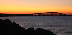 This old bridge... (EmAhLeeLove.) Tags: ocean sunset sky water silhouette oregon island rocks shadows bright ripple c north smooth sound repetition carolina inlet outer herbert pea banks bonnor