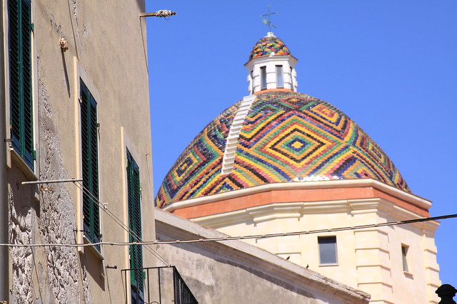 Mosaic tiles on top of the Chiesa di San Michele in Alghero, Sardinia.