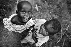 S M I L E - DR CONGO - (C.Stramba-Badiali) Tags: poverty africa travel portrait smile face childhood horizontal kids rural 35mm children person blackwhite eyes village noiretblanc expression african smiles culture blackpeople enfants congo tradition ethnic sourire humanbeing complicity humanitarian drc visage regard afrique zaire rdc drcongo blackskin congolese lookingatcamera centralafrica ethnie peaunoire lendu regardcamera forgottenconflict