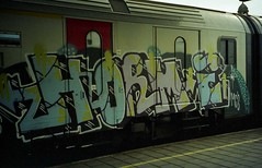 (UNKNOWN PLEASURES.) Tags: cats streetart classic 120 film analog train canon gold graffiti photo shot yeah zoom fuck snapshot super cameras 200 epson mm 135 sure mad prima piece expired ust 35 ghent gent mcs bombing perfection trein outdated nmbs horme 4490 kodal securail