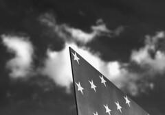 Higher Aspirations (phillytrax) Tags: city sky urban blackandwhite bw usa cloud philadelphia monochrome america stars blackwhite unitedstates pennsylvania flag unitedstatesofamerica pa american philly grayscale greyscale starsandbars