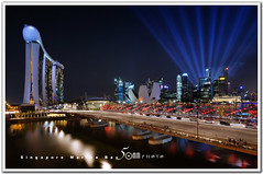 Singapore marina bay - blue laser (fiftymm99) Tags: show park bridge reflection building skyline river one hotel boat nikon singapore day fireworks rehearsal parade celebration national land ndp cbd fullerton merlion performances ntuc chartered d300 uob maybank 2011 captial stnadard fiftymm99 gettyimagessingaporeq2