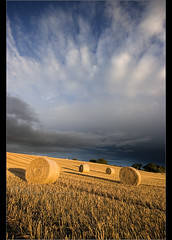 Incoming........ (Chrisconphoto) Tags: storm weather clouds sunrise harvest hay bales goodlight billinge