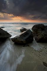 Crimson Sunset (Randi Ang) Tags: sunset seascape west crimson canon indonesia landscape eos rocks filter 5d ang lombok hitech nusa randi barat tenggara mangsit klui